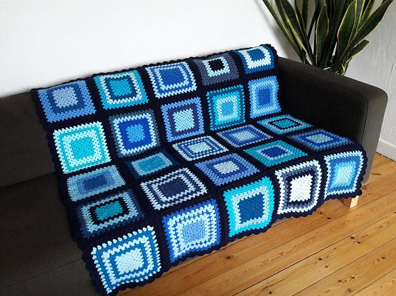 This blue afghan blanket measures 50 inches x 50 inches (127 cm x 127 cm) but can be crocheted any size you wish.