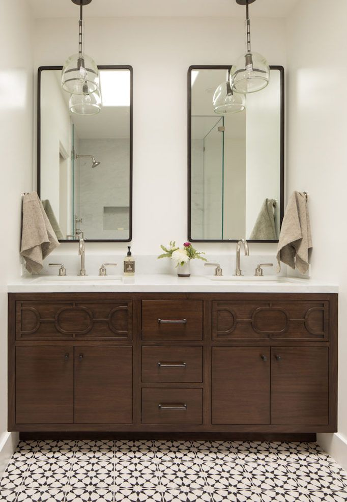 Bathroom with wood cabinets and graphic tile floor by Jute Home | Dream Home: Spanish Modern in Hillsborough featured on Becki Owens blog