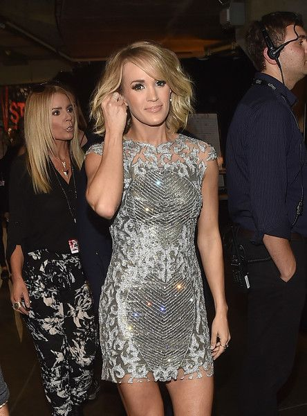 "Carrie Underwood - Sparkled in a silver mini dress during her performance of ""The Fighter"" with Keith Urban 