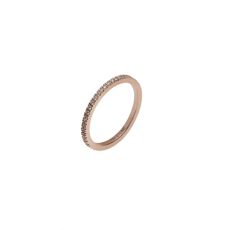 A chic 18K rose gold half band composed of sparkling brilliant cut diamonds, the Orion white gold ring is inspired by the stars that shine bright like diamonds in the sky.