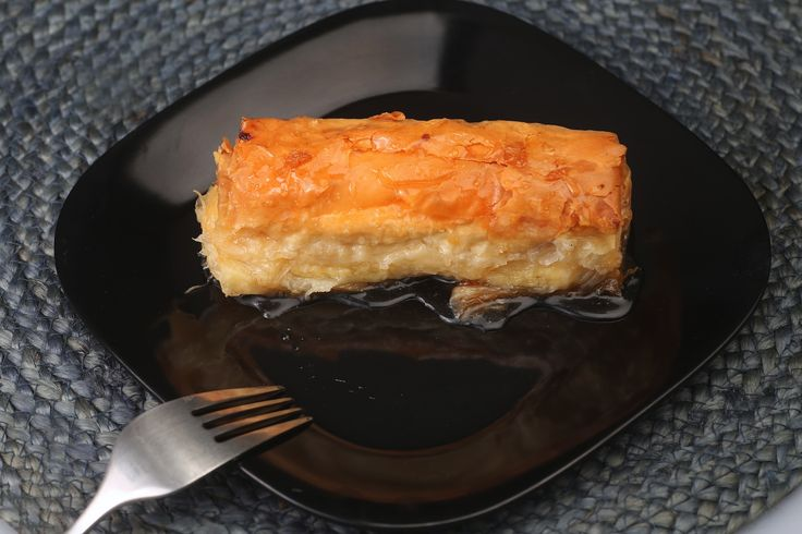 Bougatsa: Greek pastry filled with custard & covered with honey syrup