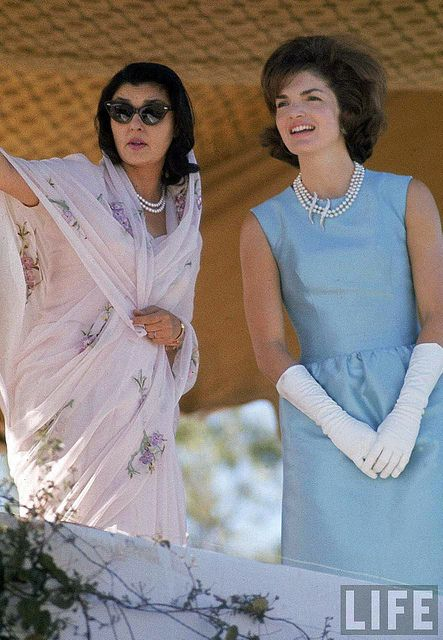 First Lady Jackie Kennedy (R) in blue sheath dress and white gloves w. Maharani of Jaipur, Gayatri Devi at Polo Ground on a visit to India. Jaipur, India by manhhai, via Flickr