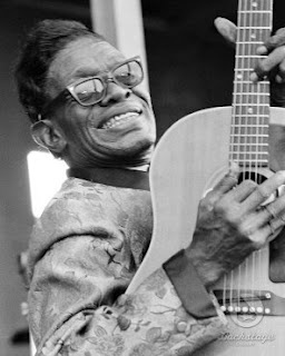 Sam (Lightnin') Hopkins, supreme acoustic blues picker, though he occasionally played electric.  Lightnin' reportedly never signed a recording contract.  He recorded for cash--pay for play--which accounts for the sheer volume of his discography and the variety of labels offering his music.