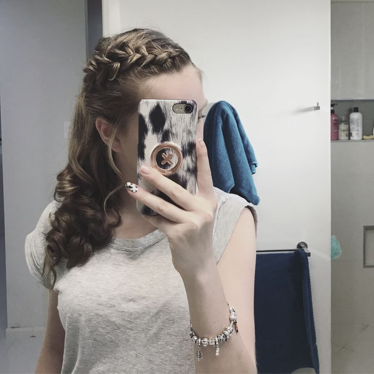 Beautiful hairstyle perfect for any special occasion. Dutch braid tied back into a pony with elegant curls.
