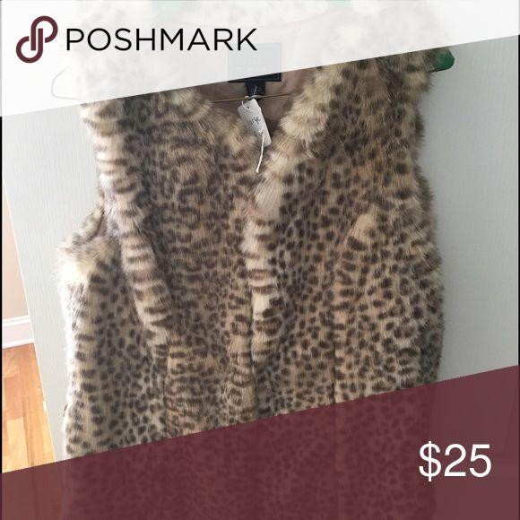 Faux fur animal print vest NWT Super soft faux fur animal print vest. Timing Other