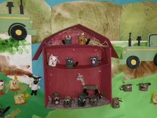 3D farm bulletin board with toilet paper roll farm animals.