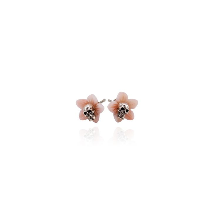 Flora Ear Studs - Handcrafted Scandinavian Design. Flora is a pair of gorgeous and slightly macabre ear studs. The petals of these blossoms, made from pale pink coral, are reminiscent of cherry blossoms in springtime. In the centre of the blooms, though, are nestled matching sterling silver skulls. With each new spring comes the death of winter, and blossoms must also die to make way for summer fruit. These delicate earrings are sure to start a conversation whenever you wear them.