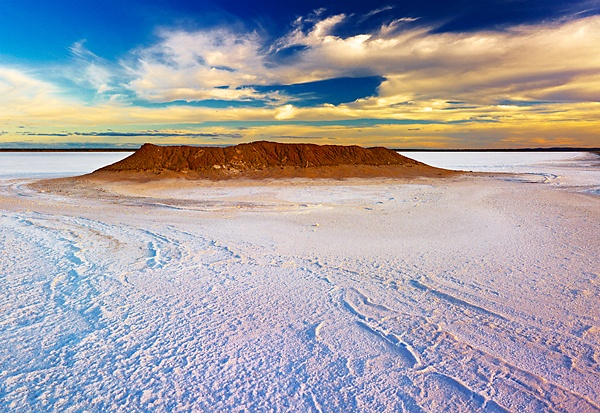 Pure white salt , clouds, blue skies and red earth collide in this image. Lake Lefroy is approximately 510 sq km in area and nestles on the edge of Kambalda near Kalgoorlie in Western Australia.