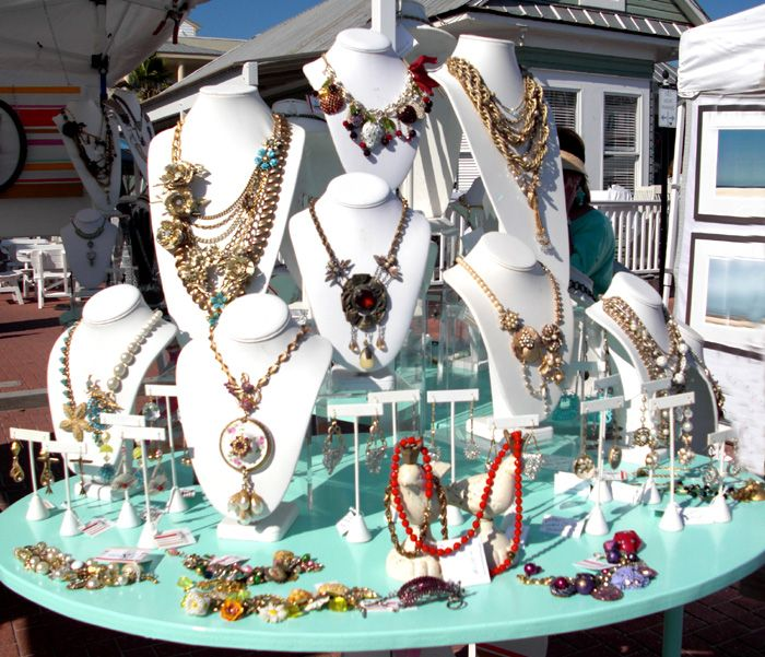 craft show displays for jewelry on a round table