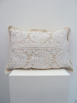 Hand embroidered cushion from Kalotaszeg, Romania... superb project and website by the way... International Wardrobe