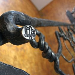 Hand wrought iron interior staircase railing - Roots - a detail