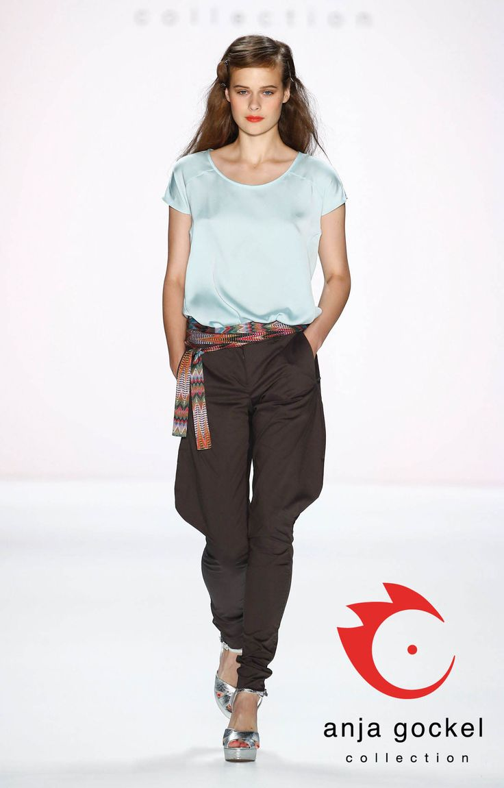 Exquisite fabrics - casual look. A loose T-shirt made from satin-silk teamed with brown equestrian-style pants smoothly caress the female body and create a unique interplay of timeless elegance and casualty.