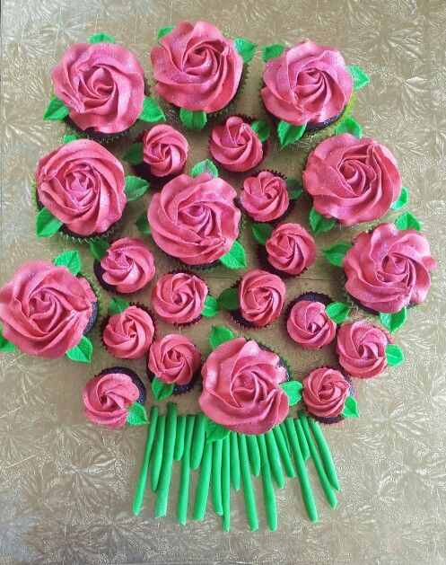 Chocolate cupcakes, raspberry  buttercream roses, fondant leaves & stems, edible glitter made by me