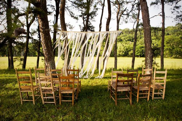 small outdoor wedding ceremony trees ribbons streamers--- a few chairs for older family and parents... simple backdrop that focuses on nature and us.