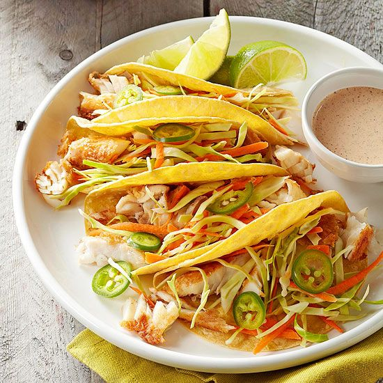 Toss together these delicious Fish Tacos with Lime Sauce in only thirty minutes! More fast-fix weeknight suppers: http://www.bhg.com/recipes/quick-easy/dinners-30-minutes-less/fast-fix-weeknight-suppers/?socsrc=bhgpin052313fishtacos=2
