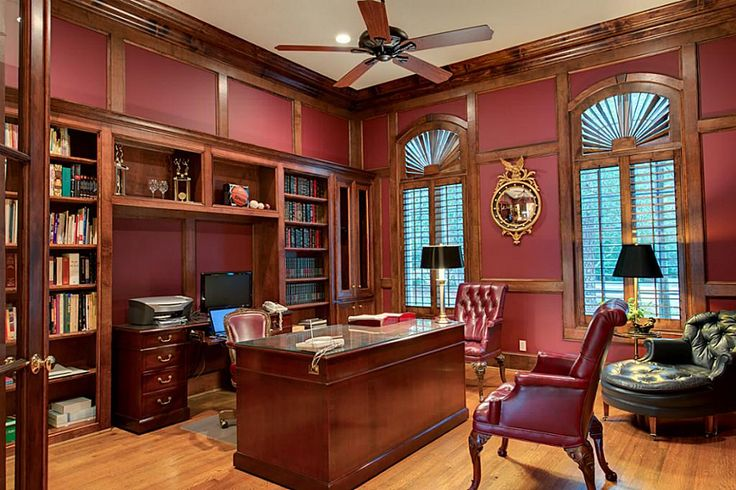 Study with maroon walls with dark natural trim