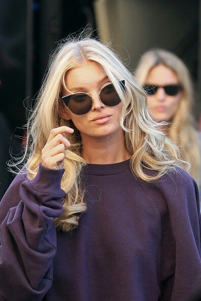Elsa Hosk in blonde curls, a sweatshirt and killer cat eye sunglasses