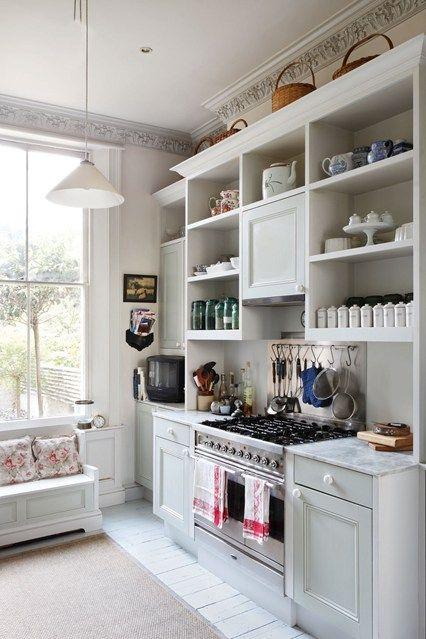 How's this for an Ikea 'hack'? Using cabinets and shelving from Ikea, design writer Lucia Van der Post's builder created two huge kitchen dressers 'the sort that you might have found in an old pantry'. He added grey marble worktops, some early Victorian-style moulding to the cabinet doors, and plain, white china knobs. The main cupboard doors are painted in 'Beauvais Grey' from Papers & Paints, while open shelving gives storage and a display for dishes and china.  From Feb2012 House…