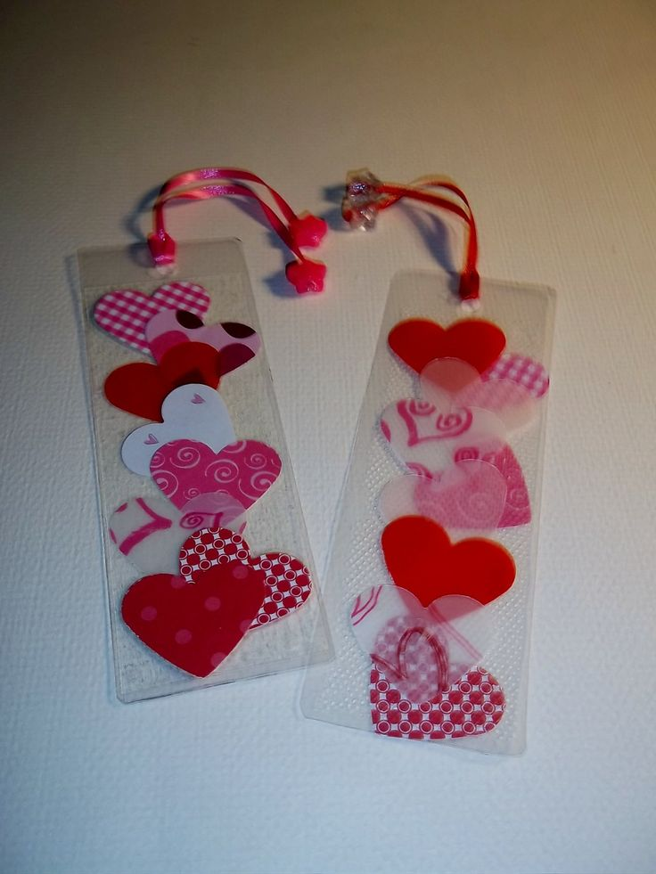 heart bookmarks~ precut hearts and seal between plastic sheets. Hole punch top & thread through ribbon.