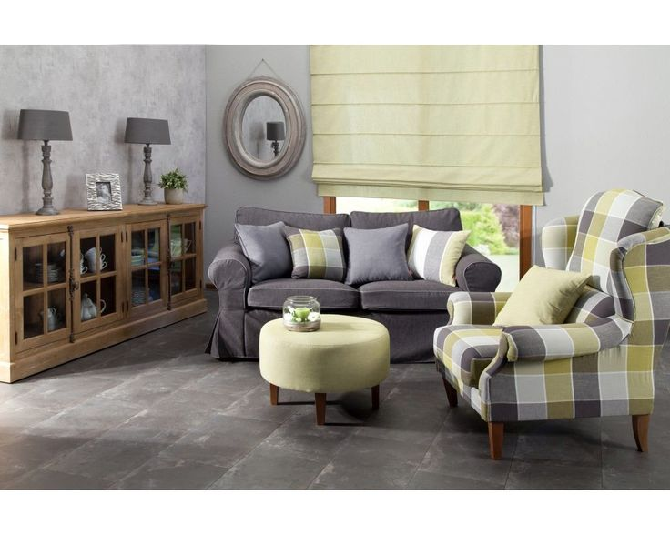 Effortless, yet stylish composition, where varicolored, patterned pillows and settees are combined with a gray couch.