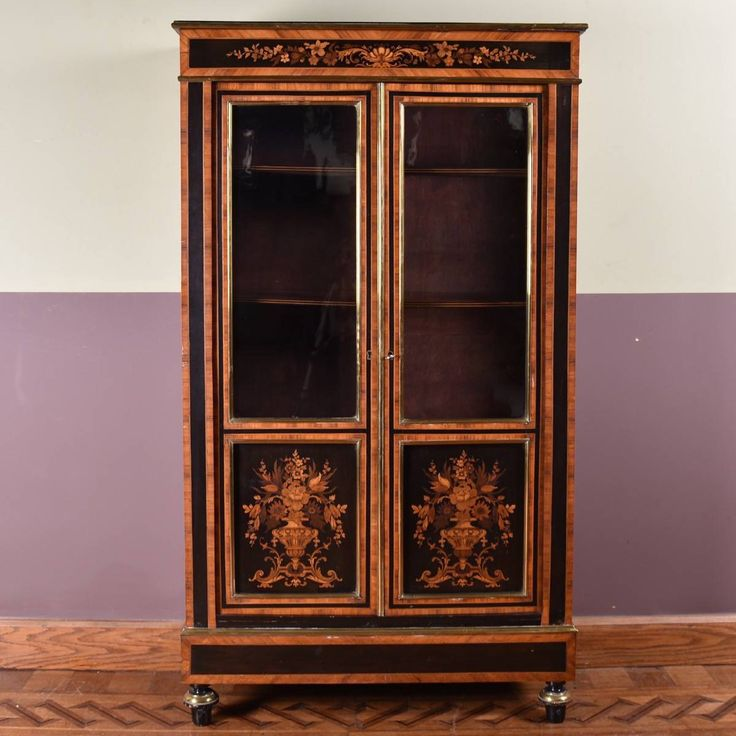 French display cabinet.  French inlaid Marquetry display cabinet with a pair of glass doors. French Antique furniture, 19 th Century.