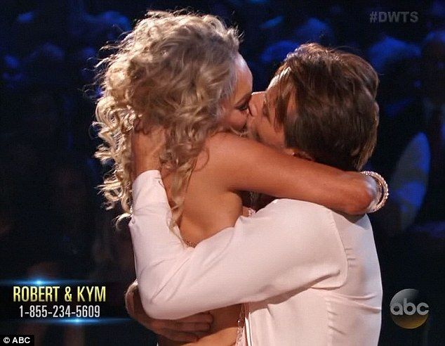 Romance: Robert and Kym shared a passionate kiss during a performance on Dancing With The Stars on Monday