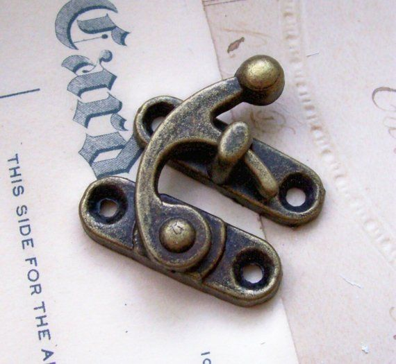 Antiqued brass curved hook box latch for altered art X 1. $2.50, via Etsy.