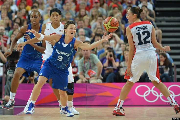 US guard Diana Taurasi (R) eyes the ball as French guard Celine Dumerc reaches for it during the London 2012 Olympic Games women's gold medal basketball game between the USA and France at the North Greenwich Arena in London on August 11, 2012.