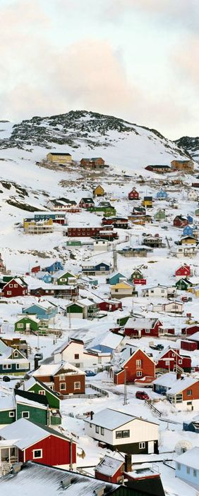 The snowy town Of Qaqortoq, Greenland. Explore Greenland with theculturetrip.com