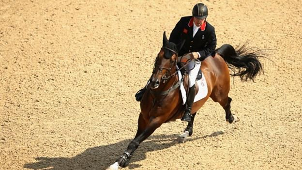 GB's Nick Skelton takes gold in the individual show jumping, winning a six-way jump-off to claim the Olympic title.  Skelton, riding Big Star, went clear in both opening rounds and did so again as the first to go in the jump-off.