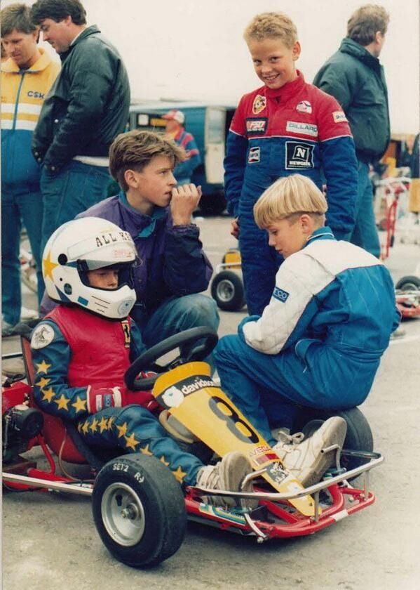Carting back in the day!    Jenson Button, Ben Collins, Dan Wheldon, Anthony Davidson  Davidson in the kart, Button stand, Collins on the front wheel, Wheldon purple sweatshirt