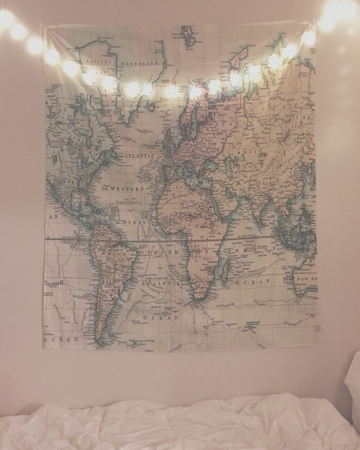 World map tapestry with fairy lights. Small dorm