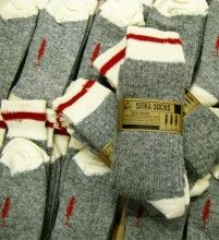 The Woolies are a classic Canadiana-inspired sock.    Whether it's the dead of summer of middle of winter, you need a pair of wool socks in your hiking boots.  With the classic red stripe at the top and a red Sitka Spruce on the foot, these socks keep look your feet looking good without the boots as well.  Sitka Wool work socks are made in Canada and come in a two-pack.
