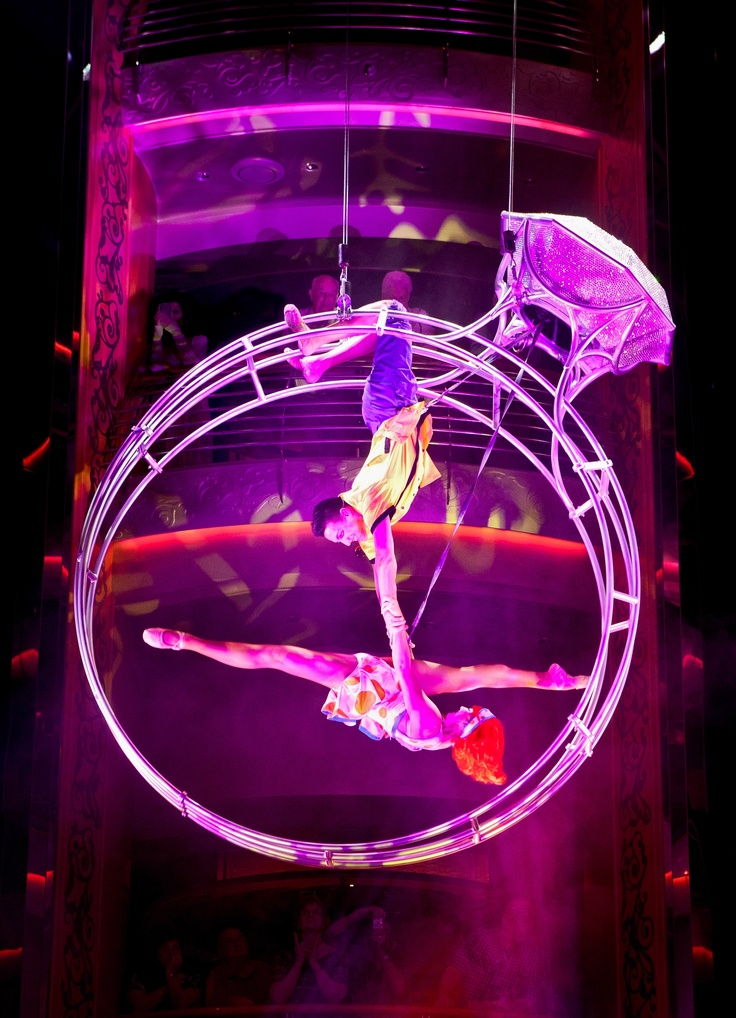 Royal Caribbean's Centrum aerialists are a thrill.  Find out where you can see them. www.facebook.com/thesource4travel