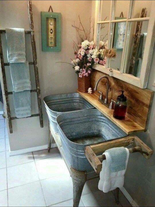 Love this very rustic. Window with mirror, old galvanized dual tubs as sinks with wood shelf and ladder as towel bar. How cool.