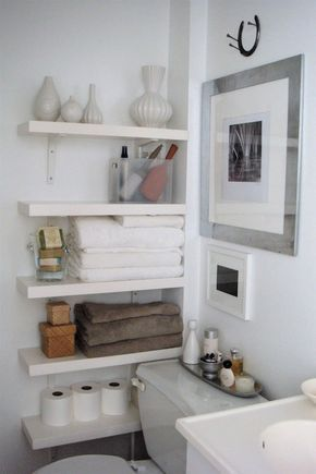 Basement Bath; The Order Obsessed: Small bathroom with lots of storage space - white floating shelves.