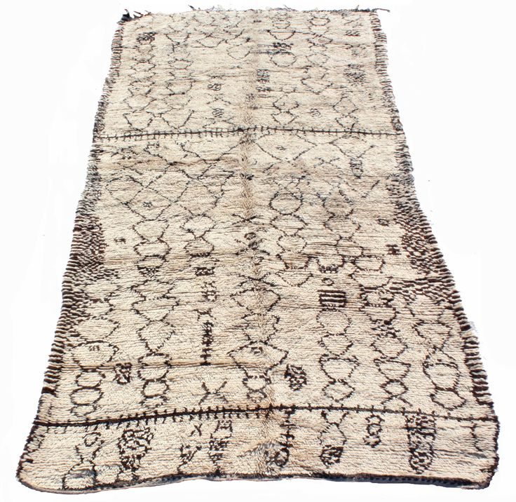 A beautiful and unusually high quality vintage Moroccan Azilal carpet, dating from around about the 1960s, with a low silky pile and complex and intricate free form Berber patterns.' Chains' of female diamond lozenges are combined with branch and cross motifs symbolizing a male theme // on sale at www.maroctribal.com