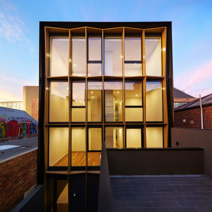 London Apartments Exterior: Golden Frames Surround The Glazed Facades Of These