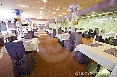 Interior of elegant restaurant with elegant table settings.