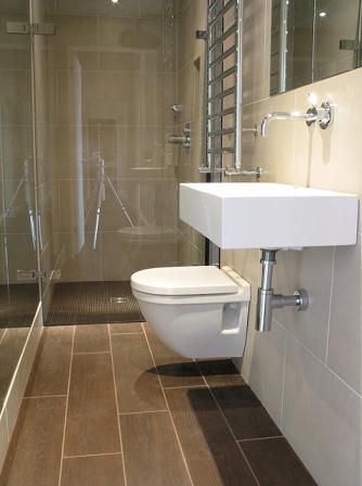 Wonderful Floor Tile Long Narrow Bathroom Design Ideas   Floating Toilet, Frameless  Glass Shower Door U0026 Mirrors On Both Walls Make Room Look Wider U0026 More Open