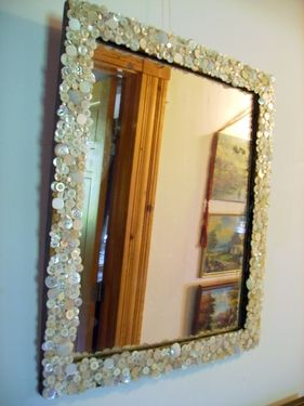 Repurpose an old mirror with mother of pearl buttons.