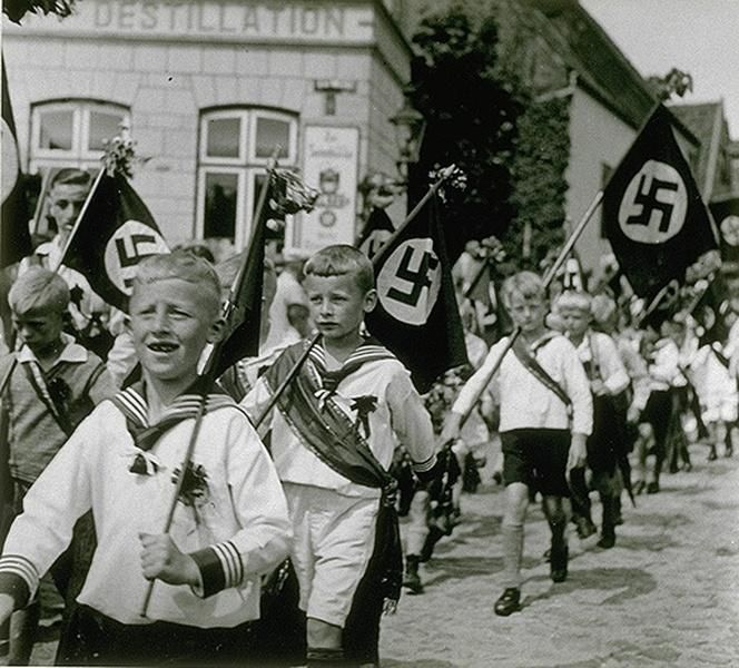 Marching boys of the NAZI YOUTH group. This is what Rudy and Tommy were involved in. The leaders they had were very harsh and physical, not a bit of pity for anyone. But the leaders were only a few years older than Rudy and yet they were corrupted with the idea of being on top of everyone. They felt the need to step on anyone they thought lower than them like destroying sand castles. Hitler Youth contributes to the theme of  social inequality.