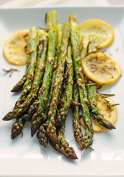 Roasted Asparagus  Ingredients  1 bundle/bunch of asparagus  1 lemon  handful of rosemary sprigs  2-tablespoons olive oil  salt and pepper to taste    roast @ 15 min @400