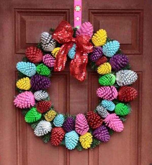 Learn how to make a gorgeous colourful or natural Pine Cone Wreath using a simple Coat Hanger. Check out the gorgeous Pine Cone Zinnia Flowers too!