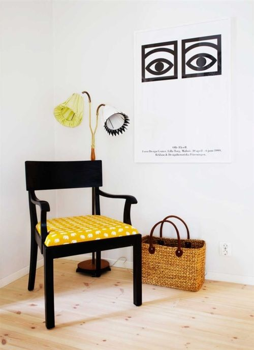 Retro poster by Olle Eksell and fabric on the chair designed by Estrid Ericson for Svenskt Tenn, Stockholm