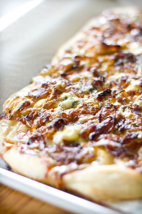 three pizzas: bleu cheese pizza with caramelized onions, bacon, and honeyed pears