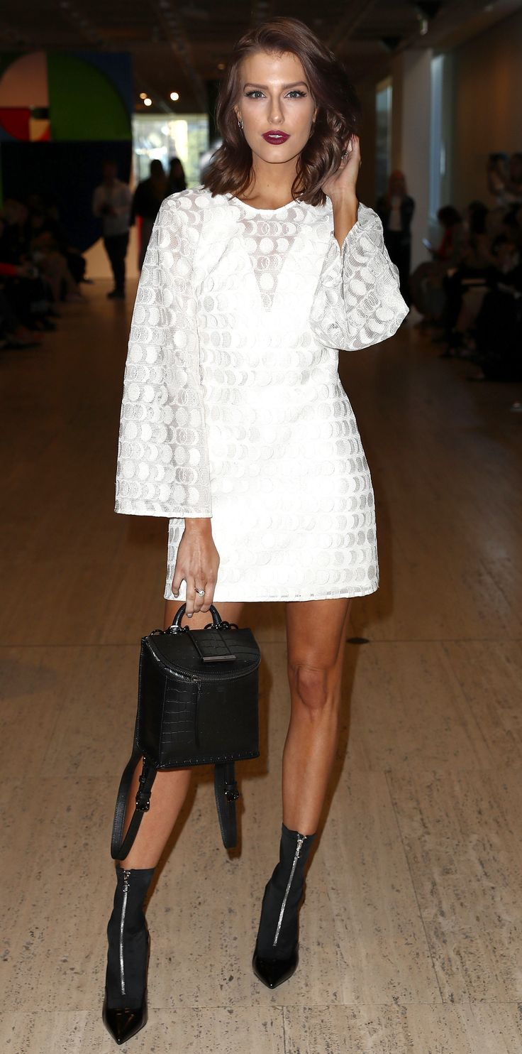 Look of the Day - Erin Holland from InStyle.com Erin Holland stunned in the front row at Australia Fashion Week in a textured white mini, zip up sock boots, and an edgy croc bag.