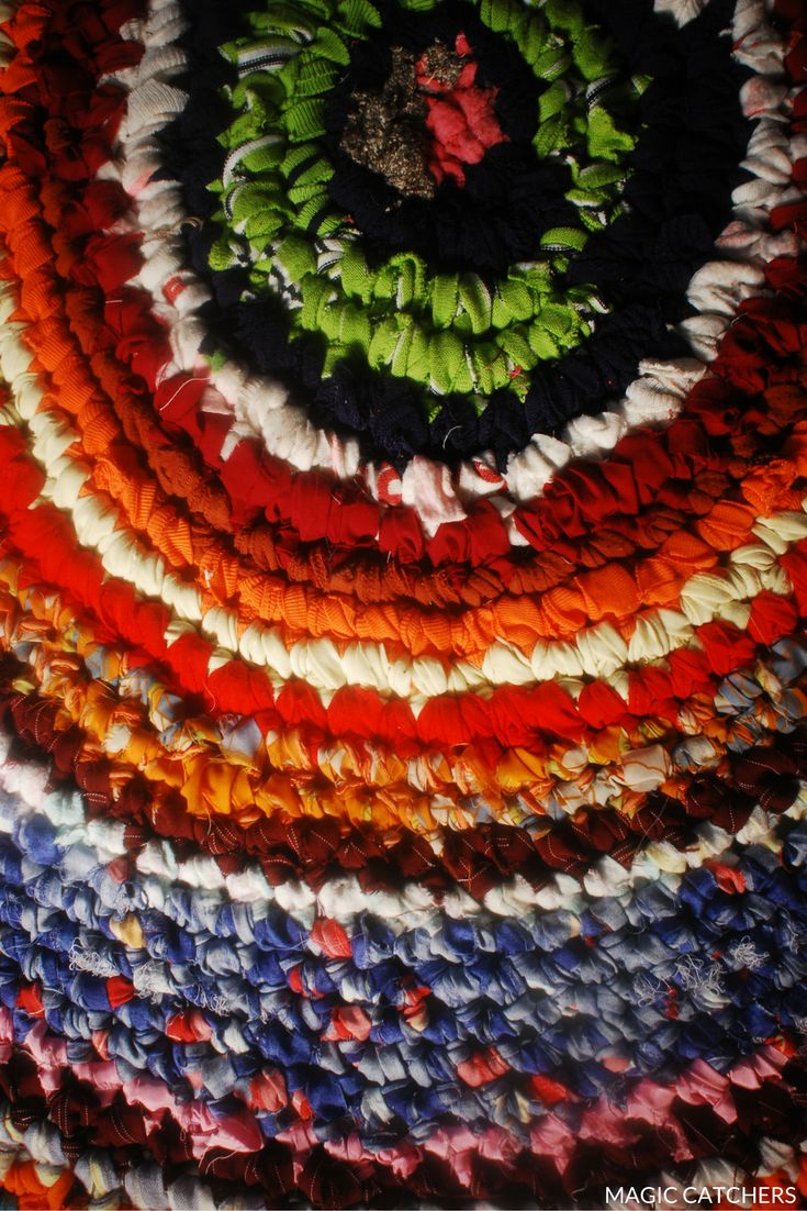 Round, colorful, rustic farmhouse style crochet carpet hand made by Magic Catchers.