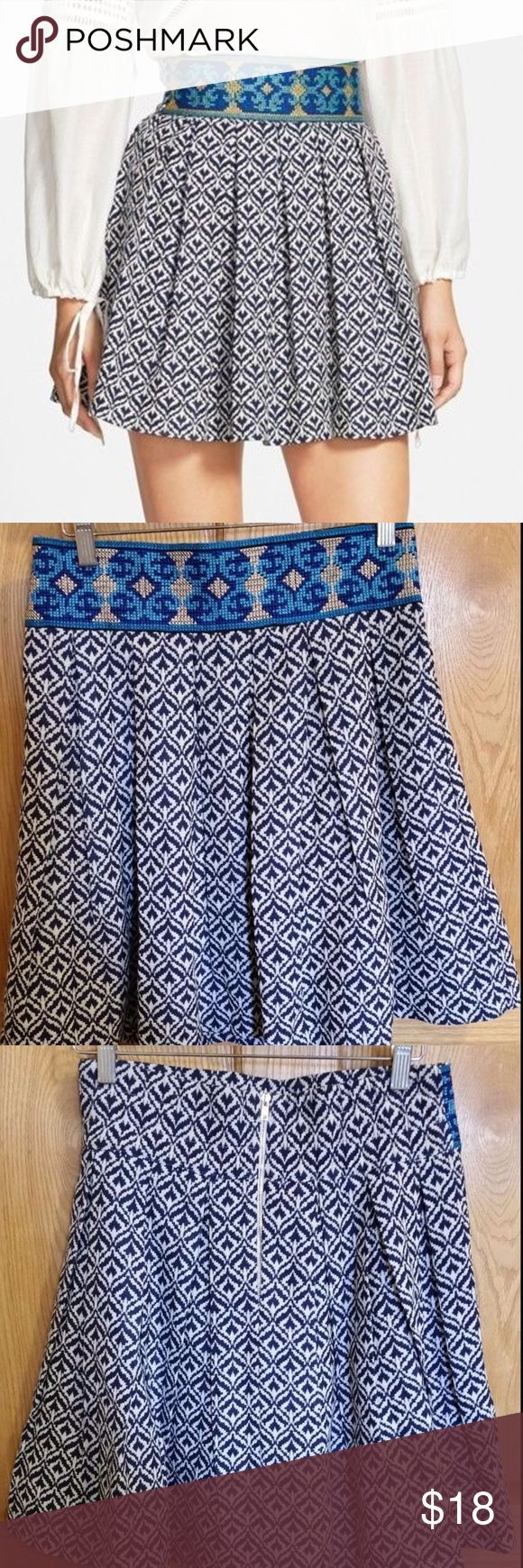 "Sister Jane Pleated Embroidered Skater Mini Skirt Sister Jane Pleated Fit & Flare mini skirt.   Size Large. - 28"" - 29""  Waist (at waist band) - 29"" Hip - 40"" Overall length - 19""   NWOT and never worn. Perfect condition! No defects, snags, stains or pulls.  Contrast folk embroidery at the waistband pleated A-line skirt with a blue tile print. Gold tone metal zipper in back and thick waist band  - No pockes - Fully lined - Thick material - Cotton 15%  polyester 85% Sister Jane Skirts Mini"