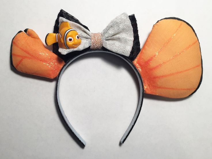 Nemo Inspired Mickey Ears. I came up with this idea while watching Finding Nemo in preparation for this summer's trip. The plastic Nemo is from the top of a Pez dispenser. My DIY Mickey Ears by NMazzie * I have a similar pair of these for sale in my Etsy Store www.etsy.com/shop/MouseEarsbyMazzie